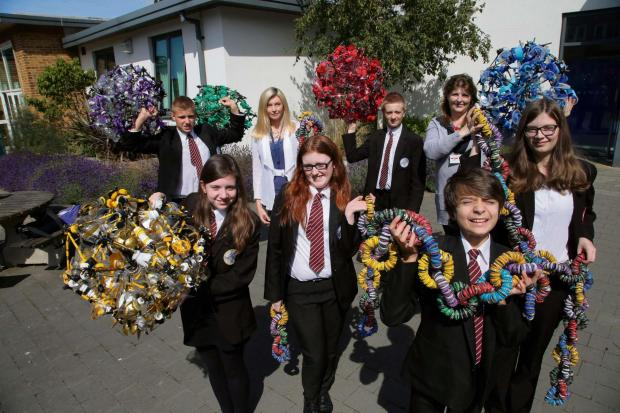 GETTING THRIFTY: Students from Hummersknott Academy, in Darlington, show off their upcycled sculptures which will be shown at the upcoming Festival of Thrift. Pictured from left are Jack McVay, 14, Lydia Barnes, 14, art and design teacher Maggie Harrison,