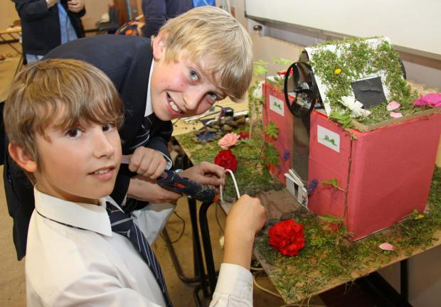 ECO-CHALLENGE: Ralph Lockey (left) and Harry Canning put the finishing touches to their team's design at Ripon Grammar School's Building for the Future challenge.