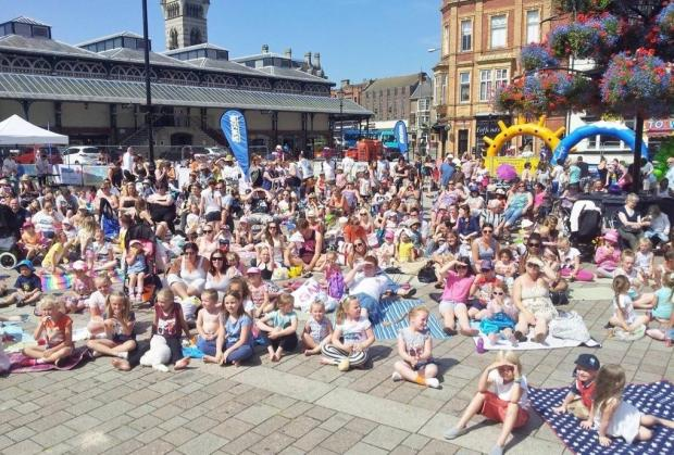BY THE SEA: Families enjoy the first Seaside Cinema event in Darlington's Market Square