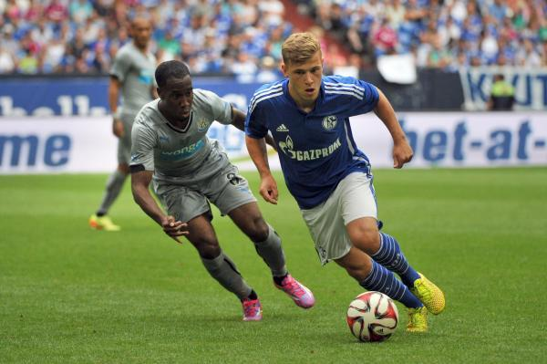 STICKING TIGHT: Vurnon Anita tracks his opponent as Newcastle beat Schalke 3-1 in a pre-season friendly