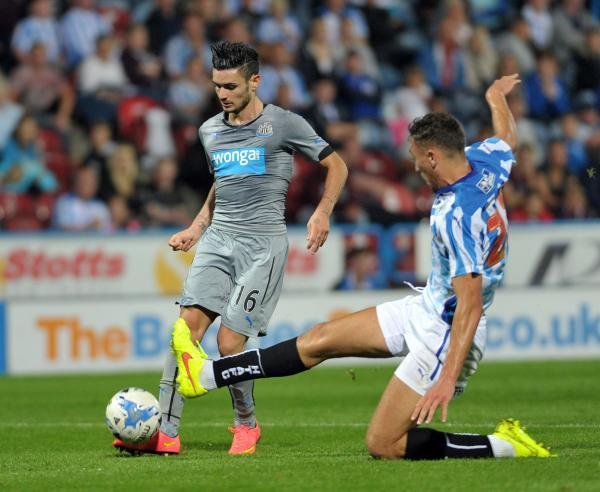 STYLISH: Remy Cabella deftly dinks the ball home to ensure a 2-2 draw at Huddersfield last night