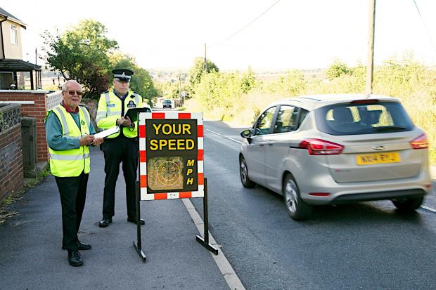 SPEED CHECK: PCSO Brian Nicholson, with volunteer Neil Pennington, check vehicle speeds in Kirk Merrington. Picture: KEITH TAYLOR