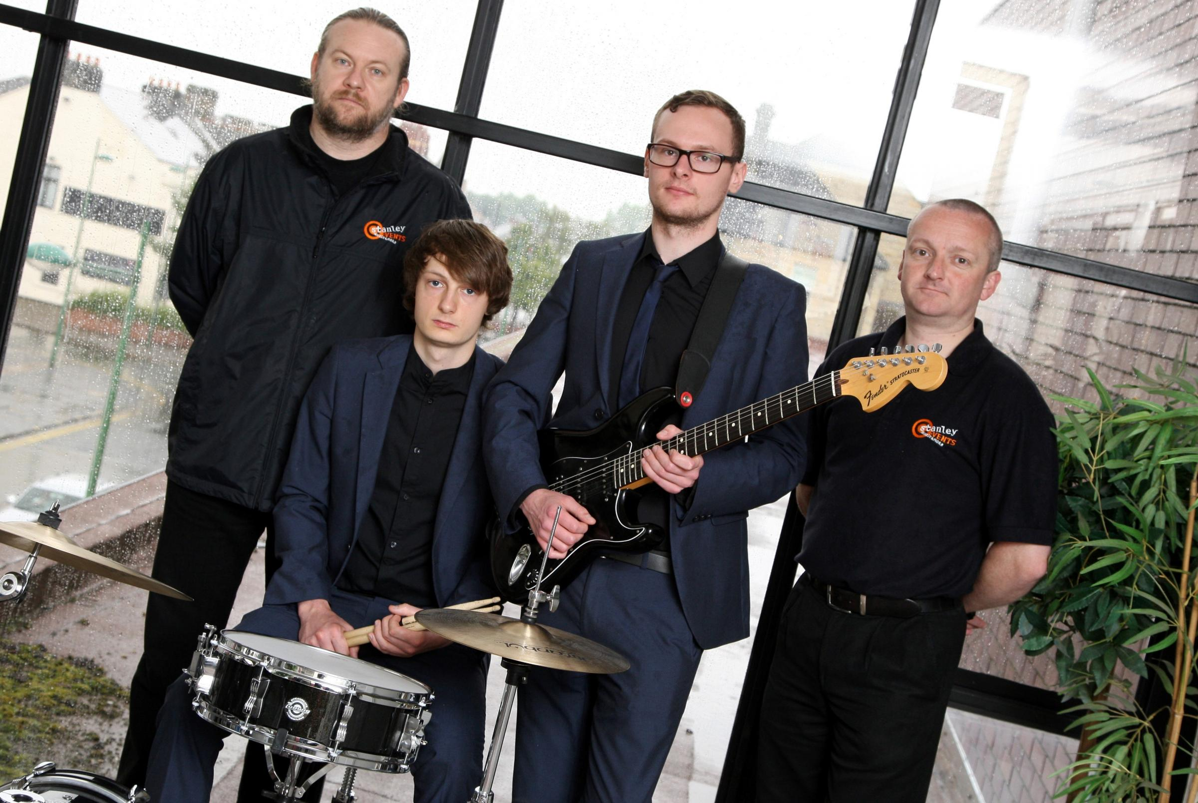 MUSIC FESTIVAL: Members of the band 'The Sponge Divers' Billy White and Jack Cummings, with volunteers Darren McMahon,  and Gareth Stones on the roof of Stanley Bowls Centre to promote an up and coming music festival in the town. Picture: TOM BANK