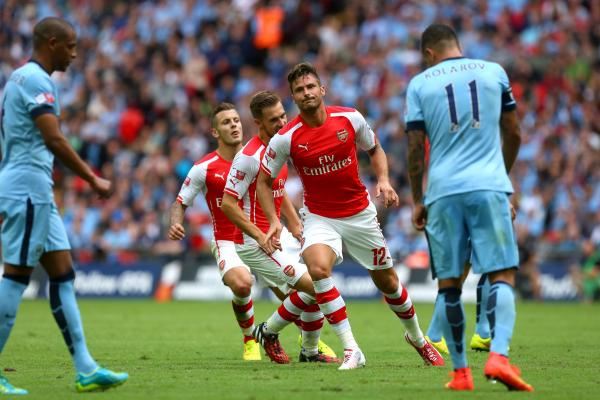 THAT WINNING FEELING: Olivier Giroud is pleased with himself after putting Arsenal 3-0 up at Wembley Stadium