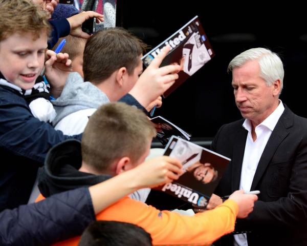 SIGN PLEASE: Alan Pardew with supporters before Sunday's friendly game