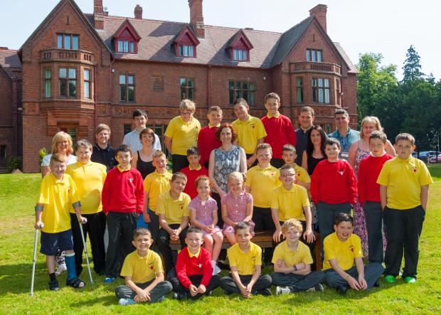 Staff and students at Marchbank Free School in Darlington pose for an end of term photograph.