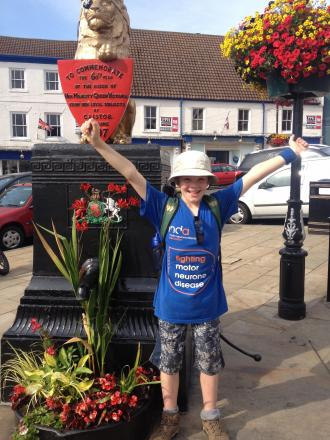 CHARITY WALK: Will Burwell celebrates finishing his 22-mile walk for the MND Association.