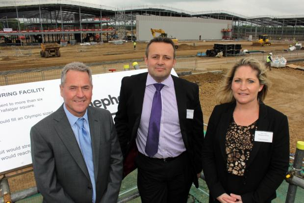 John and Julie Finley with Shepherd Construction's regional managing director Andrew Constantine (centre) on the Hitachi site in Newton Aycliffe.