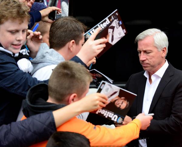 KEEPING QUIET: Alan Pardew signs autographs before yesterday's game - but he did not speak to the media afterwards.