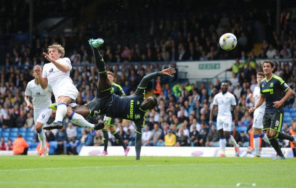 RULED OUT: Albert Adomah takes off and connects with the ball, as defender Stephen Warnock goes the other way – but the goal was controversially ruled out by referee Stuart Attwell