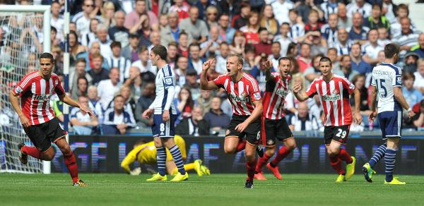 DREAM STRIKE: Lee Cattermole celebrates after scoring Sunderland's first goal of the season