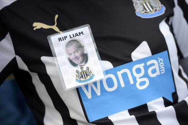 A badge on a replica club shirt as a tribute to Newcastle United supporter Liam Sweeney who lost his life in the Malaysia Airlines flight MH17 disaster, outside the ground before the Barclays Premier League match at St James' Park