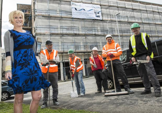 WORK BEGINS: Coast and Country's lesley Conroy with site workmen at Regent House