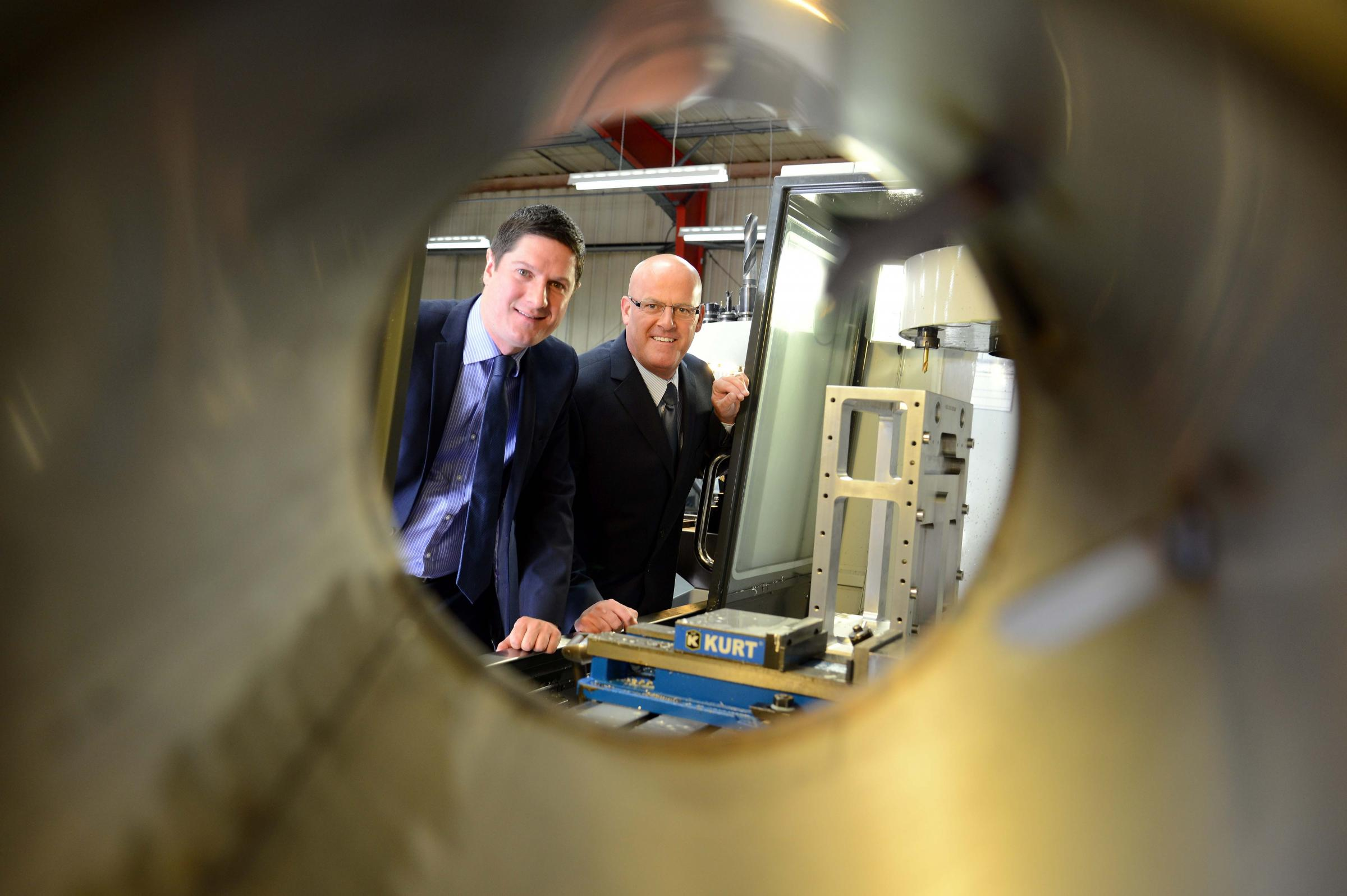 AMBITIOUS PLANS: Matthew Elliott (left), Barclays relationship director, with Peter Coates, managing director of Durham Precision Engineering