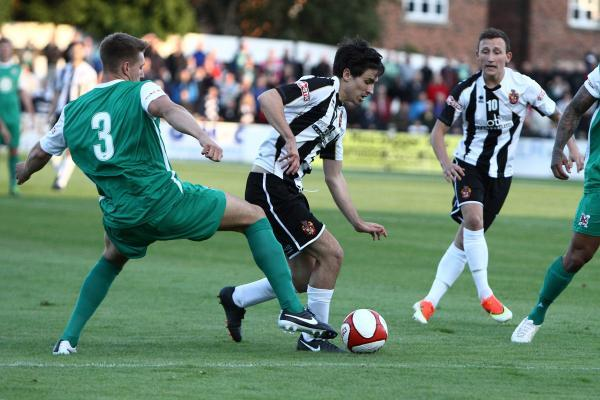 BATTLE: Moor's Adam Mitchell is marked by Darlington's Terry Galbraith