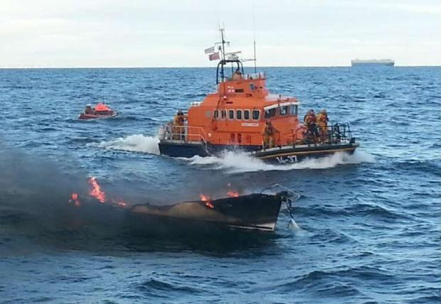 Burning yacht off coast of Seaham, County Durham, with Hartlepool RNLI lifeboats.