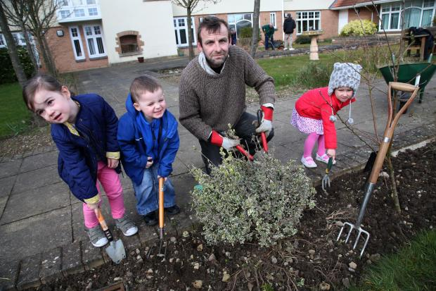 BIG DIG: Nursery children along with adults at the Pioneer Care Centre join in the Big Dig on their garden in March. From left Isobel Bowyer, four, Christopher McQue, four, medical herbalist Mark Bonham and four year old Rudi Latherton.