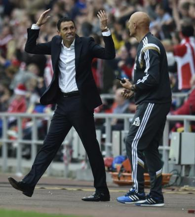 HAPPY MAN: Gus Poyet celebrates Jack Rodwell's equaliser against Man United