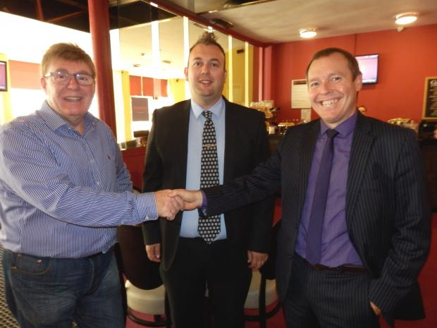 MOUNTAIN CHALLENGE: Brian Morton (left) presents his sponsorship to Damien Wilson (right) and Councillor Stephen Akers-Belcher (centre) at the Hillcarter Hotel.