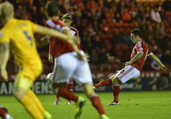 GREAT STRIKE: Lee Tomlin curls home the opening goal of Middlesbrough's 3-1 win