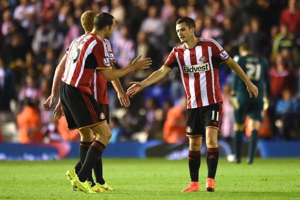 WELCOMING THE COMPETITION: Adam Johnson, pictured right, after scoring at Birmingham on Wednesday