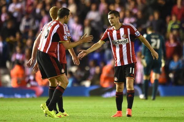 CUP JOY: Adam Johnson, right, celebrates his goal with team-mate John O'Shea during last night's 3-0 Capital One Cup win at Birmingham City
