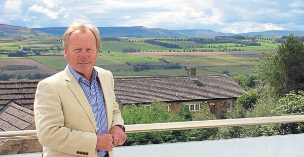 BRIGHT NEW FUTURE: Mike Charlton on the balcony of the apartment now offered for sale in the former Leyburn Cinema