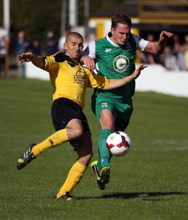 CUP CLASH: Graeme Armstrong attempts to go beyond West left-back Lewis Galpin