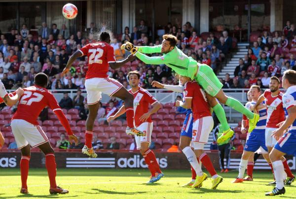 DEFENCE FIRST: Middlesbrough goalkeeper Tomas Mejias clears a corner with help of team-mate Kenneth Omeruo during Saturday's Championship defeat to Reading at the Riverside Stadium