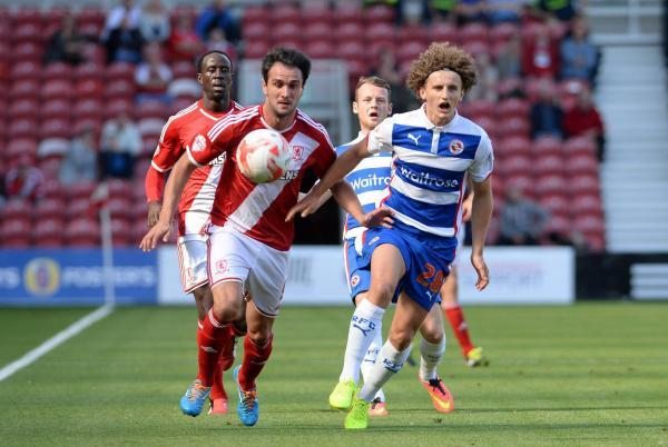 FOOT RACE: Boro's Kike races for the ball with Reading youngster Aaron Kuhl during the Teessiders' narrow defeat on Saturday