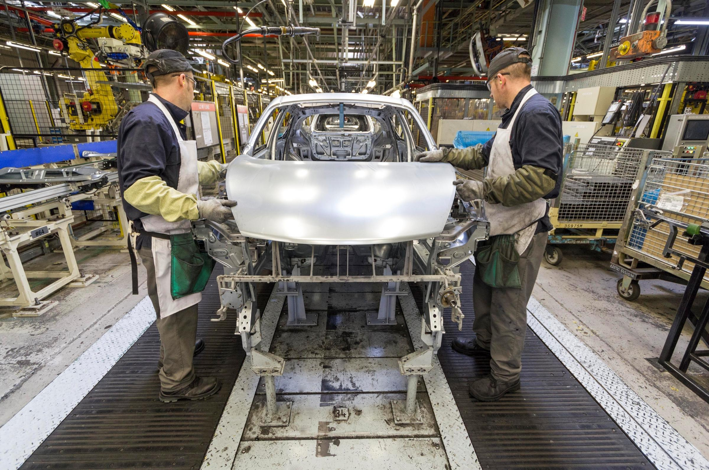 FACTORY WORK: Nissan staff fit a bonnet to a Juke at the firm's Sunderland plant