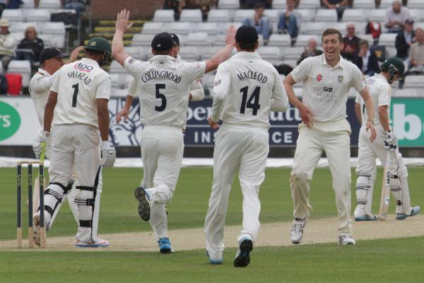GOOD FIRST IMPRESSION: Durham congratulate Peter Chase after he took the wicket of Nottinghamshire's Ajmal Shahzad - one of five the debutant took in a crucial win for the hosts.