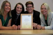 Longfield School's new head boy Connor Chapman and head girl Yeva Creegan with the national parental engagement award and head teacher Susan Johnson, left, and deputy head Sarah Davidson
