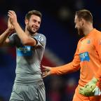 The Northern Echo: UP FOR THE CUP: Newcastle United's Paul Dummett (left) celebrates at the end of the game with team mate Rob Elliot during the Capital One Cup Third Round match at Selhurst Park on Wednesday