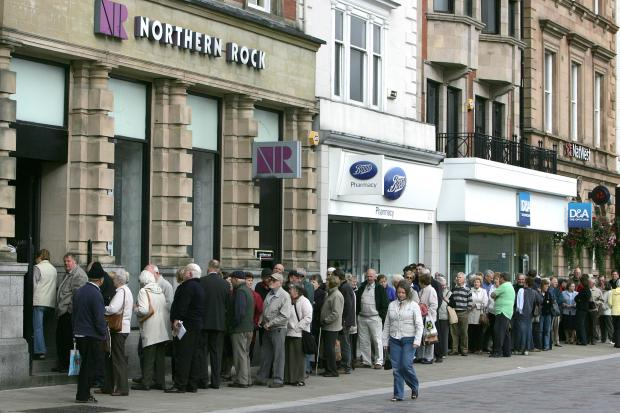 The Northern Echo: WORRYING TIMES: People queue at a former Northern Rock branch, in Darlington's High Row