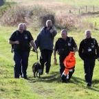 The Northern Echo: Neighbourhood wardens leading away a muzzled American bulldog belonging to Stephen Potts (in purple top). Picture: GAVIN ENGELBRECHT (11777236)