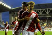 GOAL: Middlesbrough's Patrick Bamford celebrates with George Friend (left) after scoring his side's first goal during the Sky Bet Championship match at the DW Stadium
