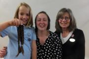 LOST LOCKS: Helena Teasdale (centre), a year two teacher at Sedgefield Primary School, sacrificed seven inches of hair to help the Little Princess Trust create wigs for children who have lost hair through cancer treatment. She is pictured with pupil Grace
