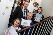 XMAS CARD: John Blissett Barnard Castle Mayor with the winners of the town's first Christmas card competition, pictured from left Scarlett Daniels 6, Lewis Kipling 9 and Alice Crossling 12 Picture:SARAH CALDECOTT