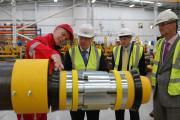 DUKE VISIT: Technician Mark Henry, left, describes a J-Tube simulator to the Duke of Gloucester on his visit to Darlington's Subsea Innovation, watched by managing director Martin Moon and factory manager Tony Forster.        Picture: ANDY LAMB (13462469)