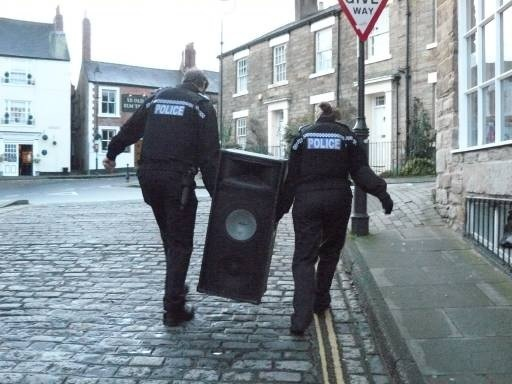 SOUNDING OFF: Police carry away sound equipment from Neville Street, Durham. Picture: Roger Cornwell