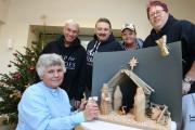 Anne Freestone,  with (left-right) Chris Morgan, Bob Taylor, Ted Granger and Andy Lake from Phoenix House, Catterick Garrison and the nativity scene they hepled to create.
