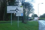 WRONG WAY: The signs direct patients over the roundabout, instead of left towards Harewood Surgery