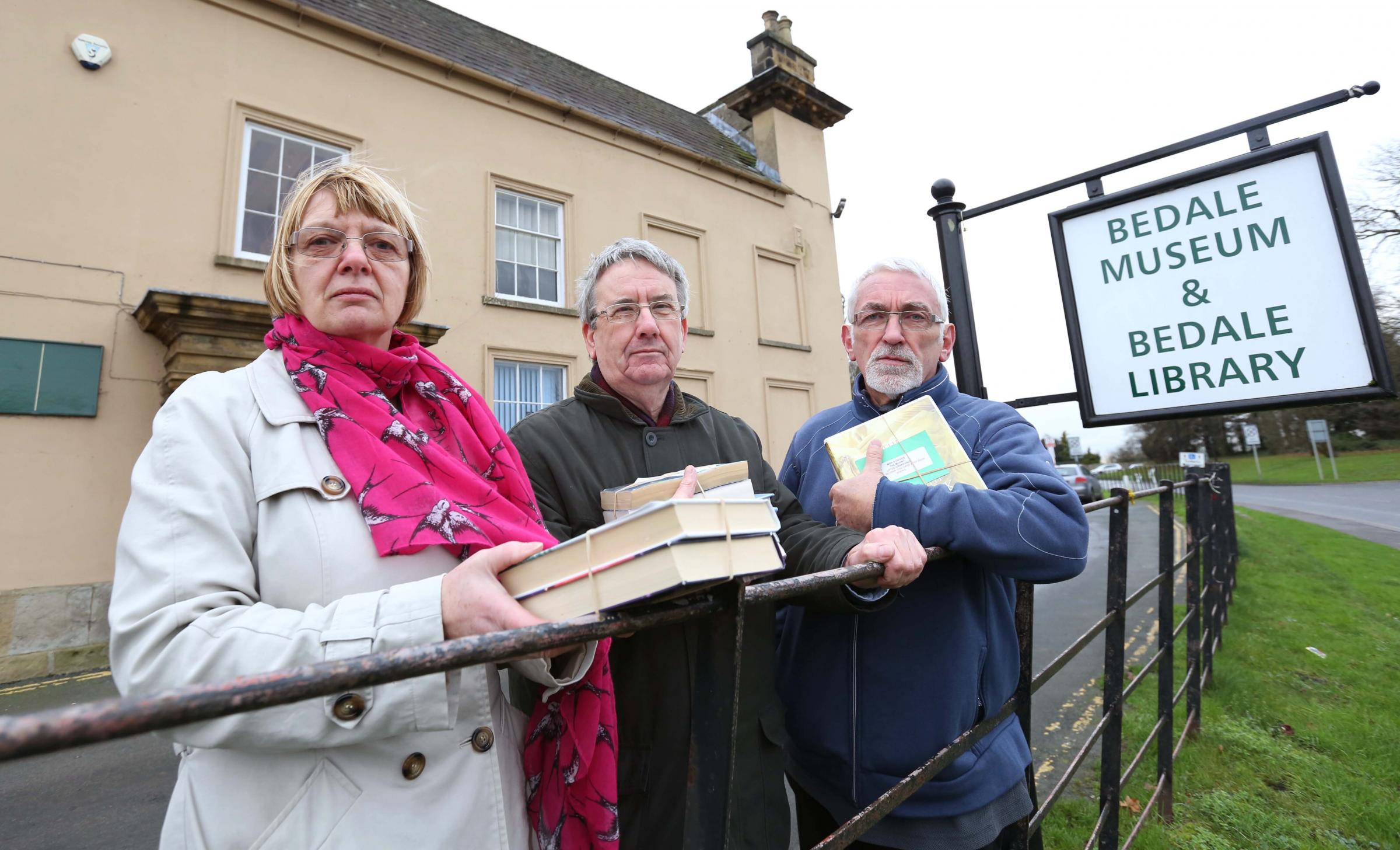 Susan and Peter Perkins with Andrew Hallett (right) outside Bedale library. Picture:RICHARD DOUGHTY