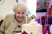 BIRTHDAY GIRL: Gladys blows out her candles surrounded by family and friends at St Germain's Grange Day Centre PICTURE: Dave Charnley Photography Ltd