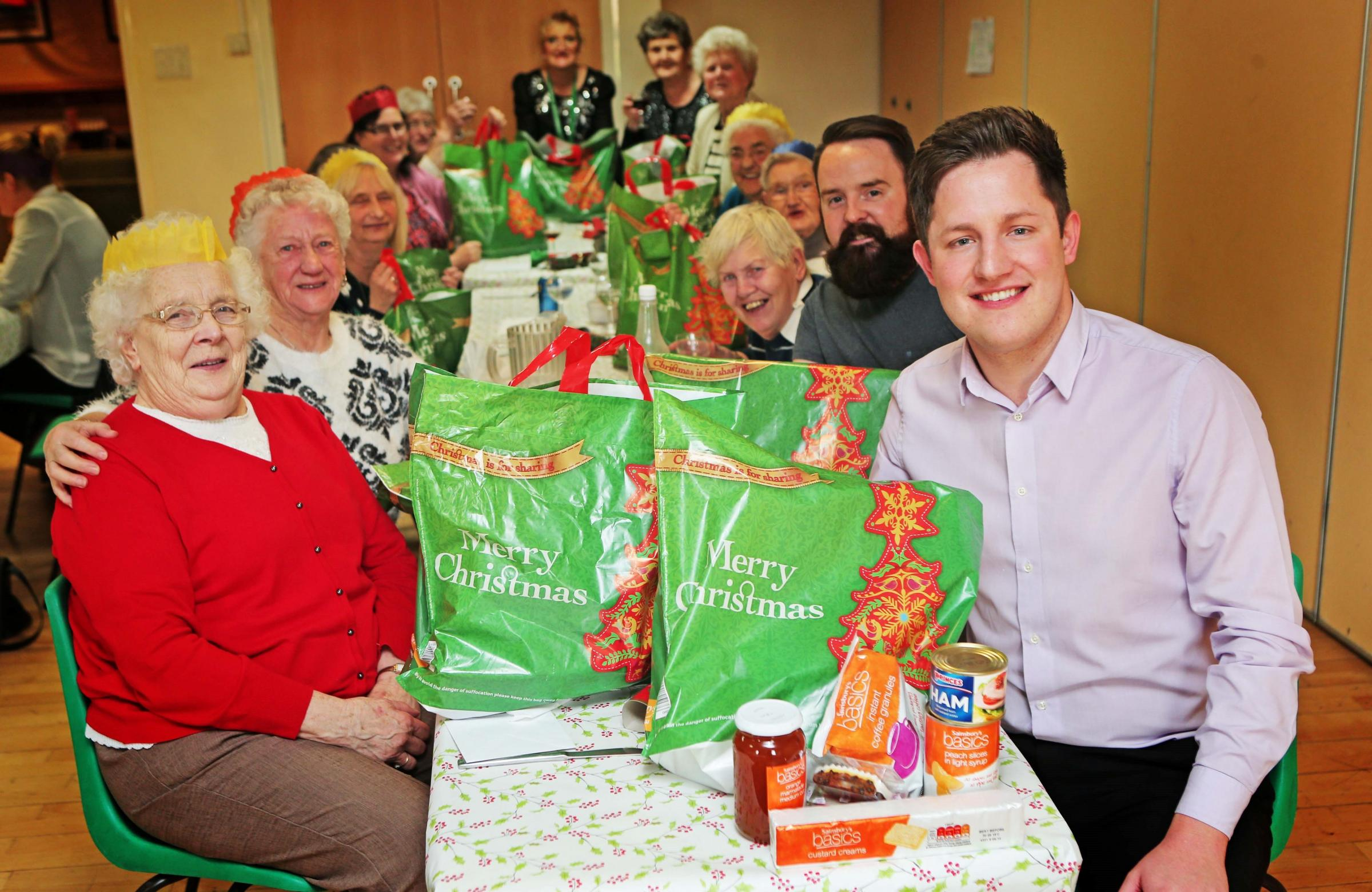 HAMPER GIFTS:Members of the Firthmoor over 50's group received special hampers from Sainsbury's in Darlington pictured front with the group is  Kevin Nicholson, the chairman of Firthmoor & District Community Association  Picture:SARAH CALDECOTT