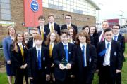 Head of Science Karen Stainthorpe, Subject Leader for Engineering Technology Ian Hall and students with the PoSBO award.