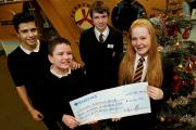 CHEQUE PRESENTATION: Ferryhill Business and Enterprise College student council members Lucy Maddison and Liam Fellow  hand over the cheque to Kyran Richmond and his brother Cameron. Picture: DAVID WOOD