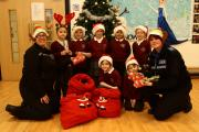 GIVING GIFTS: PCSOs Carole Hutton and Kerri Bassom hand out gifts to kids at Seaham Trinity Primary School. Picture: TOM BANKS (14955415)