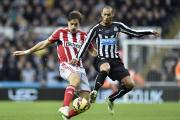 Newcastle's Yoan Gouffran and Sunderland's Sebastian Coates during the Barclays Premier League match at St James' Park, Newcastle. Picture: OWEN HUMPHREYS/PA